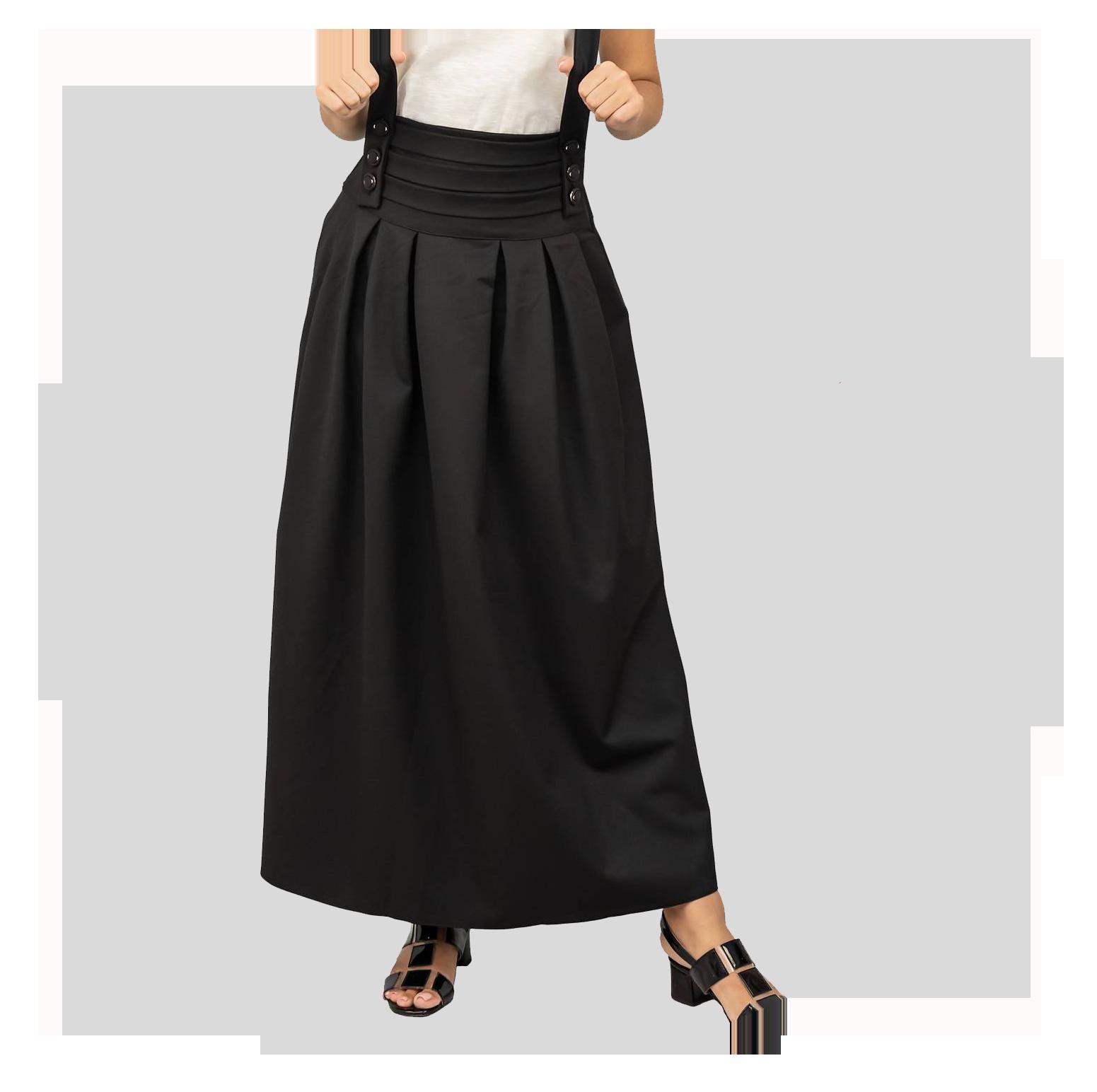 γυναίκα με μαύρη φούστα μπροστά από γκρι φόντο